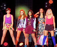The Saturdays performing in September 2011 (L–R: Frankie Bridge, Una Healy, Vanessa White, Rochelle Humes and Mollie King)