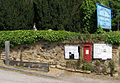The Village Stocks and wall of St Mary the Virgin Church, Shalford - geograph.org.uk - 1317725.jpg