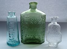 Three empty bottle medicine bottles, the centre on embossed with the words 'Dicey and Co. True Daffy's Elixir