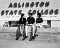 Three students sitting in front of Arlington State College sign (10008777).jpg