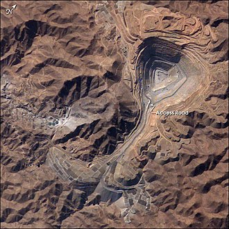 Southern Copper Corporation - Toquepala Mine in 2003, viewed from ISS . The open pit was then  2.5 kilometers across.