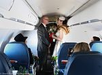 Two Delta fans tie the knot (32524099852).jpg
