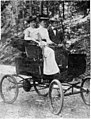 """Two women (one of whom is Alfred Whittington's daughter) and 1 man on Hot Springs Mountain Drive, riding in """"horseless carriage (cfcb0952-d3dc-4fab-8c42-69c4ad0dbb74).jpg"""