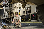 U.S. Air Force Senior Airman Wyatt Belinskey, an aerial porter with the 455th Expeditionary Aerial Port Squadron, chains down a mine-resistant, ambush-protected vehicle aboard an Air Force C-17 Globemaster III 131002-F-YL744-124.jpg