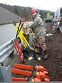 U.S. Air Force Tech. Sgt. Ralph Hetzel, with the 141st Civil Engineering Squadron, Washington Air National Guard, prepares equipment for a search and rescue effort at the site of the mudslide in Oso, Wash 140327-Z-RI264-003.jpg