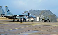 U.S. Airmen with the 48th Air Expeditionary Group maintain an F-15C Eagle aircraft at Siauliai Air Base, Lithuania, March 7, 2014 140307-F-XB934-212.jpg