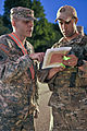 U.S. Army Spc. Justin Jackson, left, assigned to Alpha Company, 1st Battalion, 179th Infantry Regiment, Oklahoma Army National Guard, and U.S. Air Force Tech. Sgt. Larry Mansell exchange information at one 130522-F-YU985-015.jpg