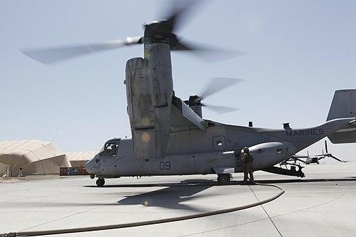 U.S. Marine Corps Sgt. Danilo Lopez, an MV-22B Osprey tiltrotor aircraft crew chief with Marine Medium Tiltrotor Squadron (VMM) 264, refuels an Osprey at Camp Bastion in Helmand province, Afghanistan, March 31 130331-M-BU728-251