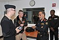 U.S. Navy Gunner's Mate 1st Class Jordan Melancon, left, a facilitator for Battle Stations 21, explains to Saudi navy Rear Adm. Dawi Mohammed Saad al-Otaibi, second from right, how facilitators communicate 121107-N-IK959-422.jpg