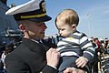 U.S. Navy Lt. Carl Odom, the supply officer aboard the guided missile destroyer USS Stout (DDG 55), holds his son during a homecoming at Naval Station Norfolk, Va., April 4, 2014 140404-N-KD168-172.jpg