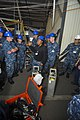 U.S. Navy Machinery Repairman 2nd Class Madison Robinson, center, an in-port emergency team instructor, addresses Sailors during a toxic gas drill aboard the aircraft carrier USS Abraham Lincoln (CVN 72) 131030-N-XP477-014.jpg