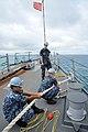 U.S. Sailors assigned to the guided missile destroyer USS McCampbell (DDG 85) heave lines as the ship moors in Okinawa, Japan, June 8, 2012 120608-N-TG831-196.jpg
