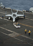 U.S. Sailors reposition an F-A-18C Hornet assigned to Strike Fighter Squadron (VFA) 146 on the flight deck of the aircraft carrier USS Nimitz (CVN 68) June 10, 2013, while underway in the Indian Ocean 130610-N-LP801-039.jpg