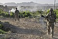 U.S. Soldiers with Charlie Company, 4th Battalion, 9th Infantry Regiment carry concertina wire during a base defense patrol around Forward Operating Base Zangabad in the Panjwai district, Kandahar province 130523-A-MX357-004.jpg