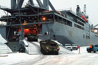 United States Transportation Command - USNS Shughart, a non-combatant RORO vessel, unloading Stryker armored vehicles