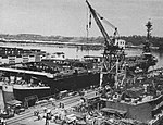 USS Sicily (CVE-118) fitting out at Todd Pacific Shipyards, in 1945.jpg