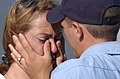 US Navy 020620-N-1110A-505 Aviation Structural Mechanic Airman Nathaniel Wellman wipes away the tears of a loved one.jpg