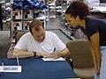US Navy 021226-N-4614W-001 comedian Drew Carey signs a birthday card.jpg