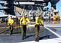 US Navy 030120-N-9403F-002 Sailors spray down sections of USS Abraham Lincoln's non-skid surface.jpg
