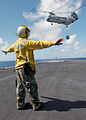 US Navy 030122-N-6895M-508 Aviation Boatswain's Mate directs a CH-46.jpg