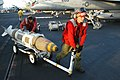 US Navy 030317-N-9593M-026 Aviation Ordnancemen move a Joint Direct Attack Munitions (JDAM) across the flight deck of the aircraft carrier USS Abraham Lincoln (CVN 72) during a break in flight operations.jpg