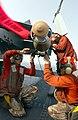 US Navy 030320-N-1810F-010 Aviation ordnancemen prepare 2,000-lb. GBU-12 guided missiles for upload to aircraft aboard USS Kitty Hawk (CV 63).jpg