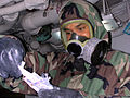 US Navy 030405-N-8935H-003 Electronics Technician 3rd Class Jimmy Reid from Gary, Ind., tests M-256 chemical detection paper during a simulated chemical air attack during a General Quarters (GQ) drill aboard the amphibious comm.jpg