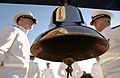 US Navy 031114-N-5862D-024 Junior class officer candidates stand next to the ceremonial bell.jpg