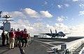 US Navy 031114-N-6213R-128 Flight deck personnel observe an F-14D Tomcat.jpg