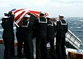 US Navy 040115-N-5027S-002 Sailors aboard USS Saipan (LHA 2) conduct a burial at sea off the coast of Virginia for a former U.S. sailor.jpg
