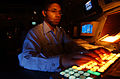 US Navy 040430-N-8977L-005 Air Traffic Controller 3rd Class Keonte Russel, of Chicago, Ill., inputs clearance information needed to deliver an aircraft to its destination during a daily routine.jpg