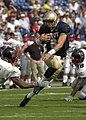 US Navy 040911-N-9693M-001 U.S. Naval Academy Midshipman 1st Class Aaron Polanco runs for a touchdown against the Northeastern Huskies.jpg