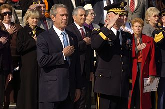 Timeline of the George W. Bush presidency (2004) - President George W. Bush and Commanding General, Maj. Gen. Galen B. Jackman pay respects to the unknown servicemen laid to rest at the Tomb of the Unknowns in Arlington National Cemetery in Virginia during a Veteran's Day ceremony on November 11, 2004