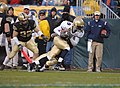 US Navy 051203-N-9693M-190 Navy wide receiver Tyree Barnes from Hampton, Va., breaks tackles while running for first down yardage, during the 106th Army vs. Navy Football game.jpg