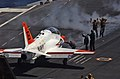 US Navy 060428-N-6484E-006 A T-45A Goshawk Trainer Jet is taxied to the catapult in preparation for launch aboard the Nimitz-class aircraft carrier USS Theodore Roosevelt (CVN 71).jpg