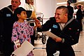 US Navy 061211-N-6536T-013 Machinist Mate Fireman Larry Shaffer of Chelsea, Okla., assigned to USS Los Angeles (SSN 688), gives a high five to a child being treated at the Los Angeles Children's Hospital while participati.jpg
