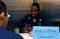 US Navy 070205-N-0555B-006 Navy Counselor 1st Class Fonda Wilson, from Hollywood, Fla., discusses career paths with a Sailor on the mess decks aboard USS Ronald Reagan (CVN 76).jpg