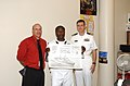 US Navy 070510-N-0318S-007 James O'Tremba, principal of Columbia Middle School, stands with Ship's Serviceman 1st Class Kelvin Birdine and Lt Cmdr. Jeff Oakey from the Precommsssioning Unit (PCU) Mesa Verde (LPD 19).jpg