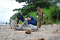 US Navy 071217-N-4774B-154 Sailors from amphibious assault ship USS Tarawa (LHA 1), guided-missile destroyer USS Hopper (DDG 70) and Marines from 11th Marine Expeditionary Unit clean trash and debris from local beaches on the i.jpg
