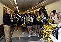 US Navy 081204-N-8273J-055 Chief of Naval Operations Adm. Gary Roughead cheers with the U.S. Naval Academy cheerleaders during a pep rally at the Pentagon.jpg