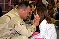 US Navy 090223-N-2425L-001 Electronics Technician 2nd Class Sam HerediaPerez greets his 7-year-old daughter during a special reunion at Dinsmore Elementary School.jpg