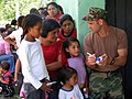 US Navy 090401-N-1580K-532 Hospital Corpsman 2nd Class Michael Behrendt, from Corpus Christi, Texas, explains the uses of certain pharmaceutical prescriptions to villagers during a Beyond the Horizon humanitarian assistance exe.jpg