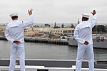 US Navy 090528-N-5586R-203 Sailors aboard to the aircraft carrier USS Ronald Reagan (CVN 76) manning the rails wave to family members as they leave their home port of San Diego.jpg