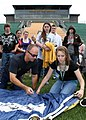 US Navy 090602-N-5366K-009 James Woods, a retired Navy SEAL assigned to the U.S. Navy Parachute Team, the Leap Frogs, shows students how to pack his parachute after the Team gave a parachute demonstration at Brooke High School.jpg