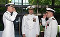 US Navy 090710-N-3090M-100 Rear Adm. Paul Bushong, commander Submarine Group 2, watches on as Capt. Peter Clarke, left, relieves Capt. Emil Casciano, right, as Commander, Submarine Squadron 2, during a change of command ceremon.jpg