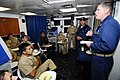 US Navy 090720-N-7092S-397 Chief Gunner's Mate Joshua Tolleson discusses maritime interdiction operation techniques with Colombian sailors during a subject matter expert exchange aboard the guided-missile frigate USS Kauffman (.jpg