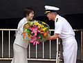 US Navy 090721-N-3283P-364 Cmdr. Jeffrey J. Kim, commanding officer of the guided-missile destroyer USS John S. McCain (DDG 56), is given a bouquet of flowers on behalf of the city of Yokohama, Japan.jpg