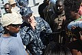 US Navy 100125-N-5700G-329 Lt. Cmdr. Steven L. Learo, assigned to the amphibious assault ship USS Nassau (LHA 4), gives instructions to Haitian citizens at a humanitarian aid distribution point in Saint Marc, Haiti.jpg