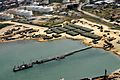 US Navy 100221-N-9643W-001 An aerial view of the White Beach logistical compound established by Sailors assigned to Amphibious Construction Battalion (ACB) 2 at Varreoux Beach in Port-au-Prince, Haiti.jpg