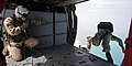US Navy 100428-N-1045B-355 Sailors assigned to Explosive Ordnance Disposal Mobile Unit (EODMU) 1 and Naval Special Warfare Unit (NSWU) 3 leap from an altitude of 10,000 feet from an SH-60 Sea Hawk helicopter during a free fall.jpg